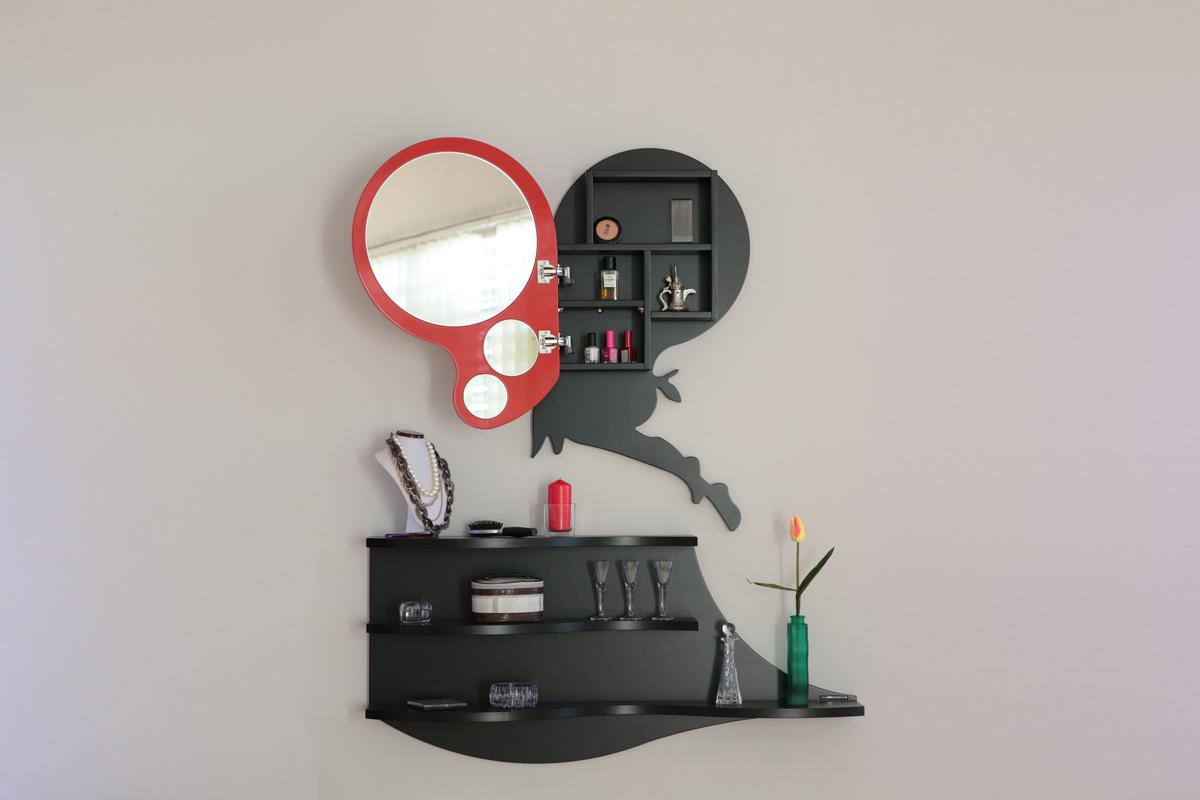 Mensola nera con sopra uno specchio aperto con all'interno dei prodotti di cosmetica