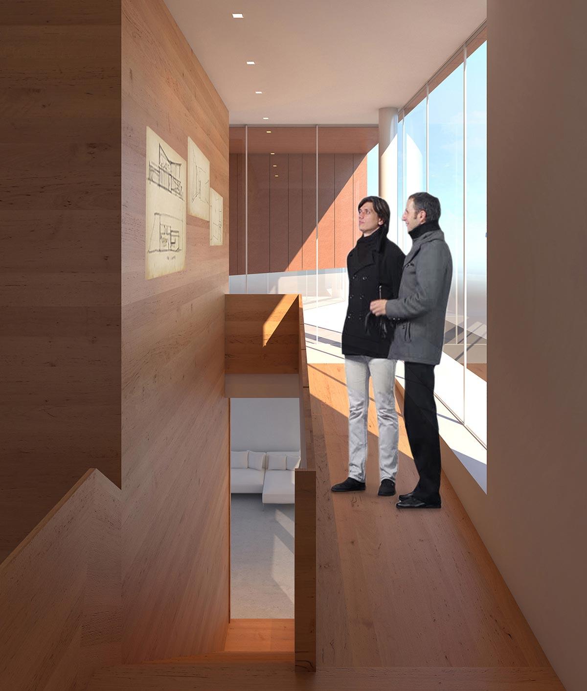 Due persone che ammirano le opere d'arte all'interno dell'edificio