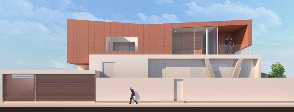 Vista frontale della O-House con una copia che discute nel balcone e una persona che passeggia sul marciapiede esterno.