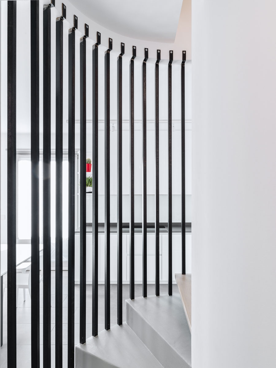 Black strips that suspend a spiral staircase