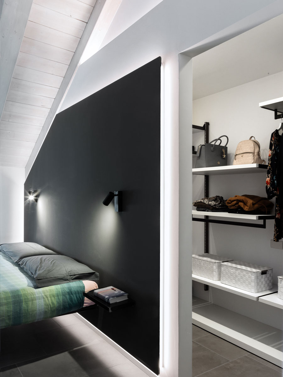 Built-in wardrobe with a double bed next to it