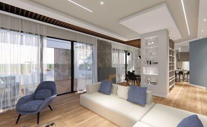 Soggiorno formato da un divano bianco, una poltrona blu e che termina in angolo con una vetrata