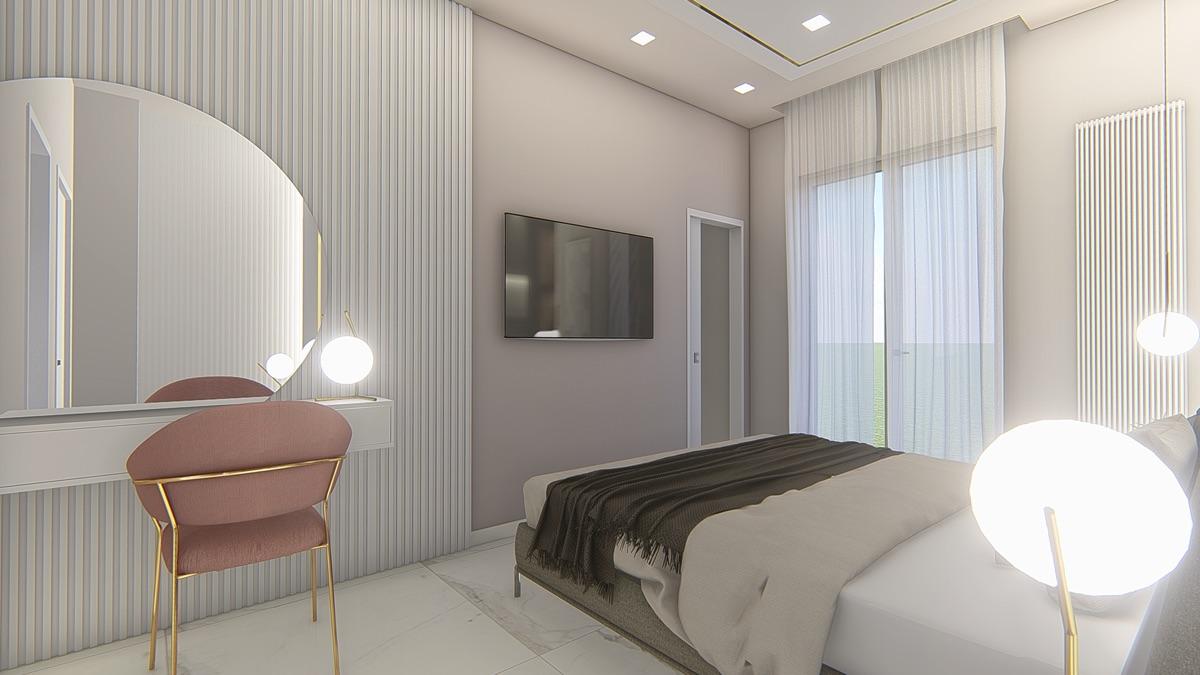 Camera da letto con un letto matrimoniale e a fianco una sedia che dà verso uno specchio