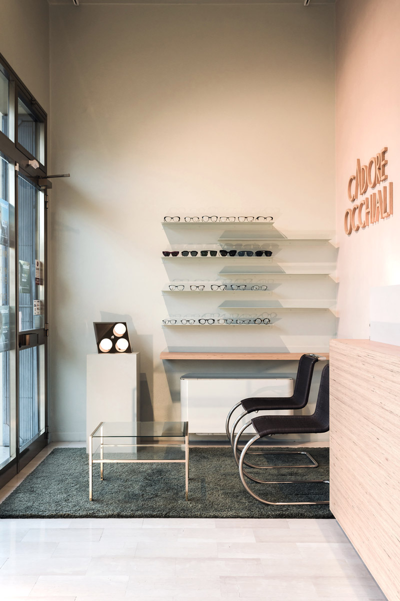 Entrance to the shop leading to the waiting room made up of a small table and a couple of chairs
