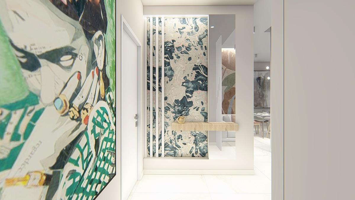 Parete decorata con un disegno a muro e uno specchio con incastonata una mensola porta oggetti